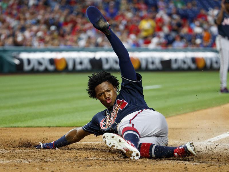 Ronald Acuña of Atlanta Braves slides into home