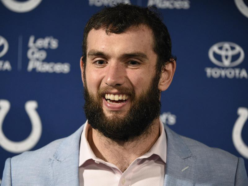 Andrew Luck talks with the media