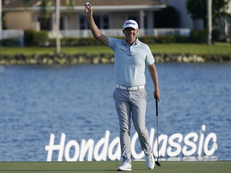 Matt Jones raises ball after winning Honda Classic golf tournament