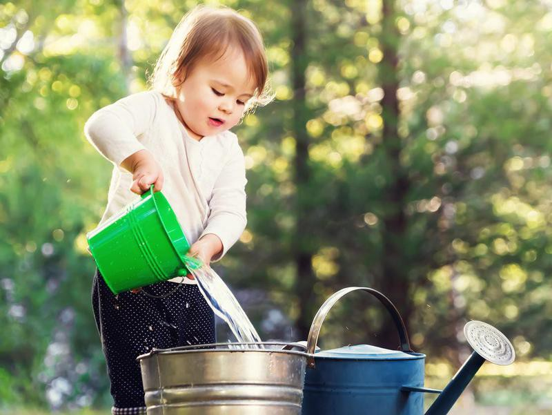 Baby playing with buckets
