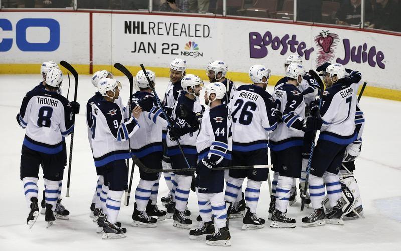 Winnipeg Jets players celebrate team win
