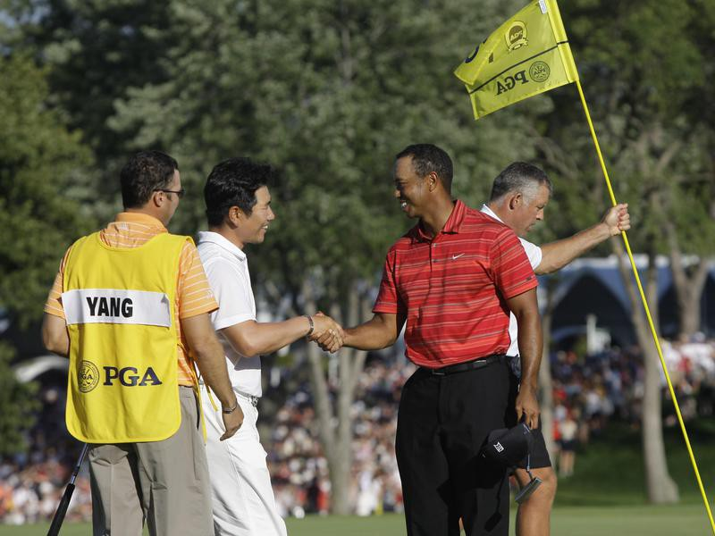 Y.E. Yang and Tiger Woods