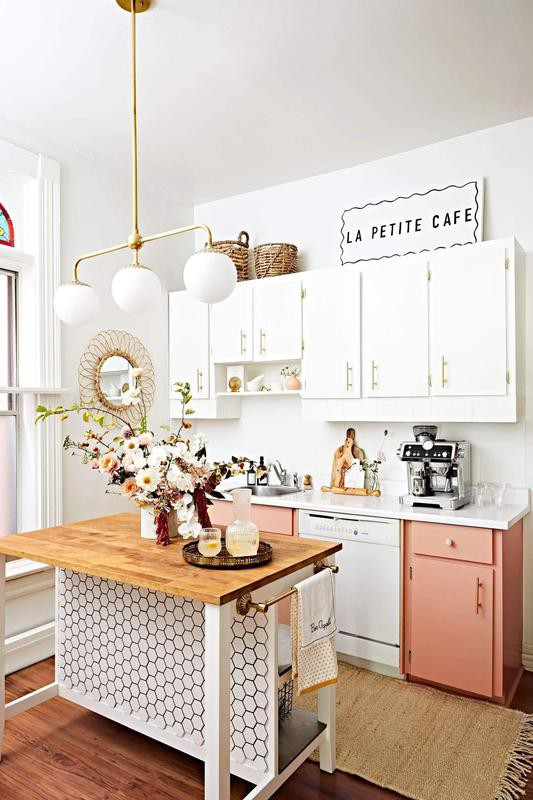 Kitchen with a honeycomb-style backsplash and pink cabinets