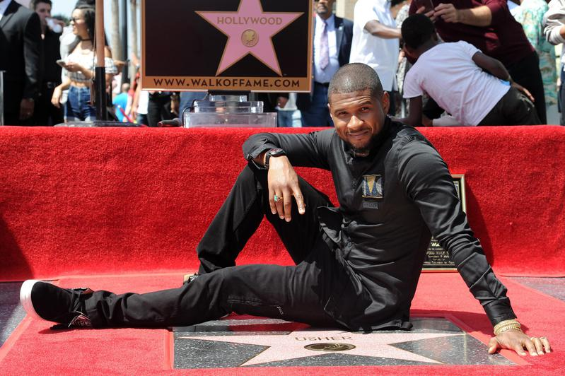 Usher attends a ceremony honoring him with a star on the Hollywood Walk of Fame in Los Angeles in 2016.