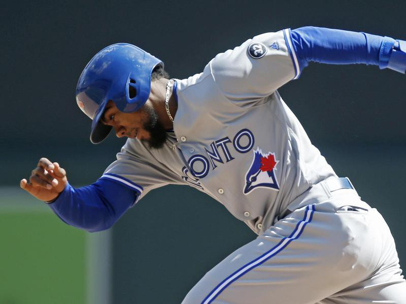 Teoscar Hernandez of the Blue Jays races to second base on a steal attempt