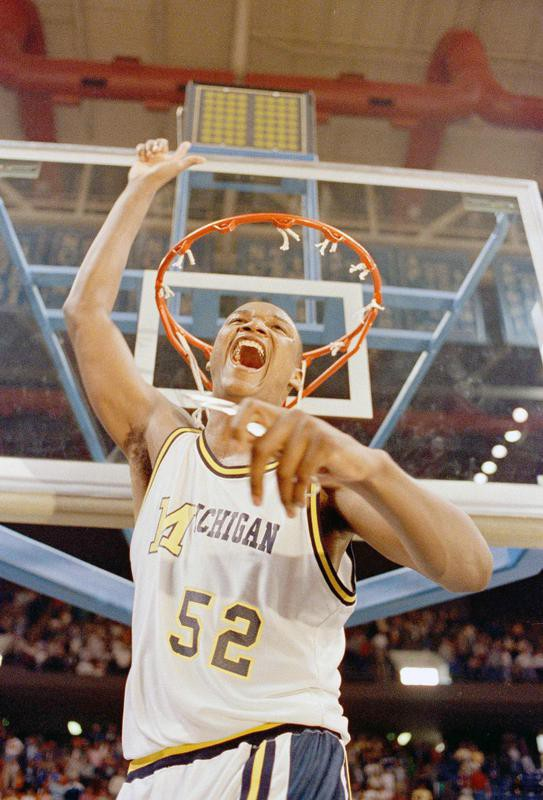 Terry Mills cuts down the net