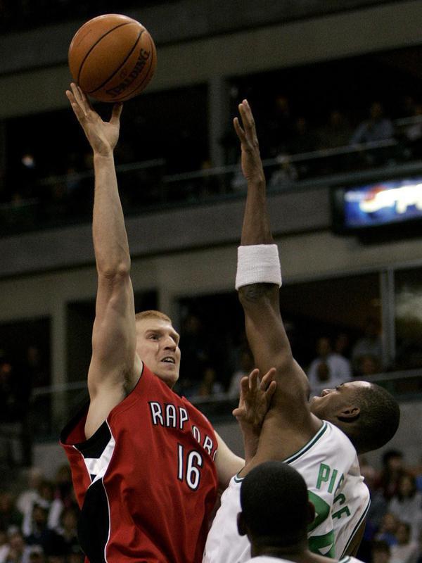 Matt Bonner shoots over Boston Celtics forward Paul Pierce