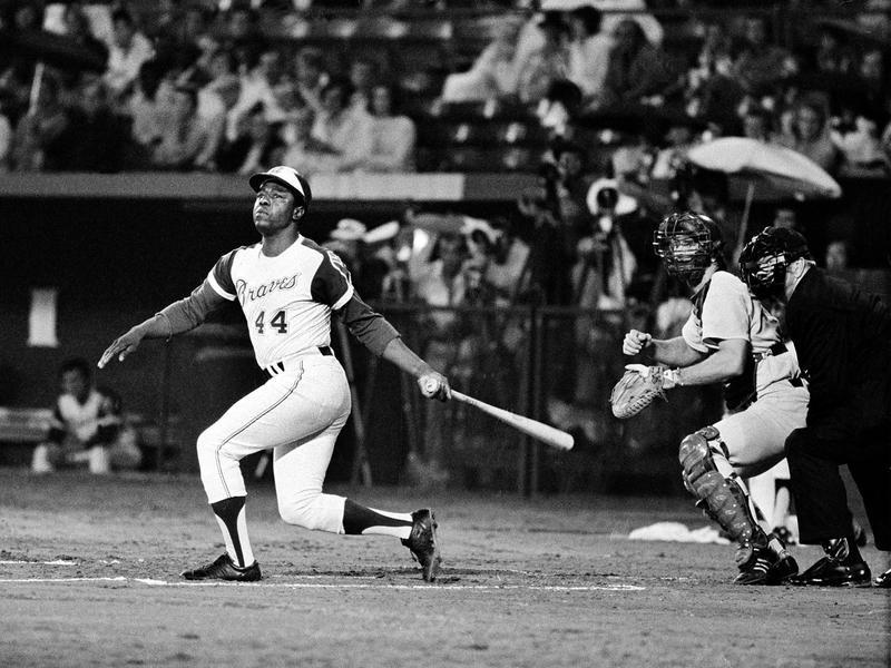 Atlanta Braves' Hank Aaron watches home run