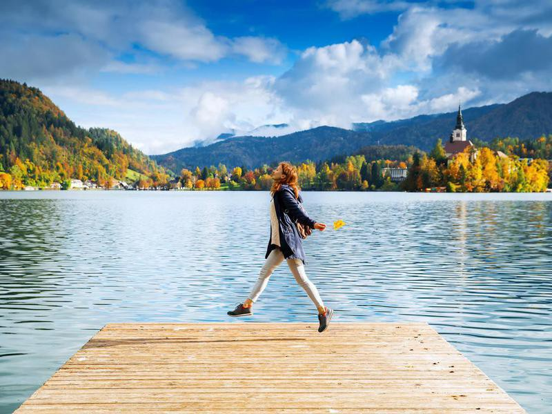 Happy woman on Lake Bled