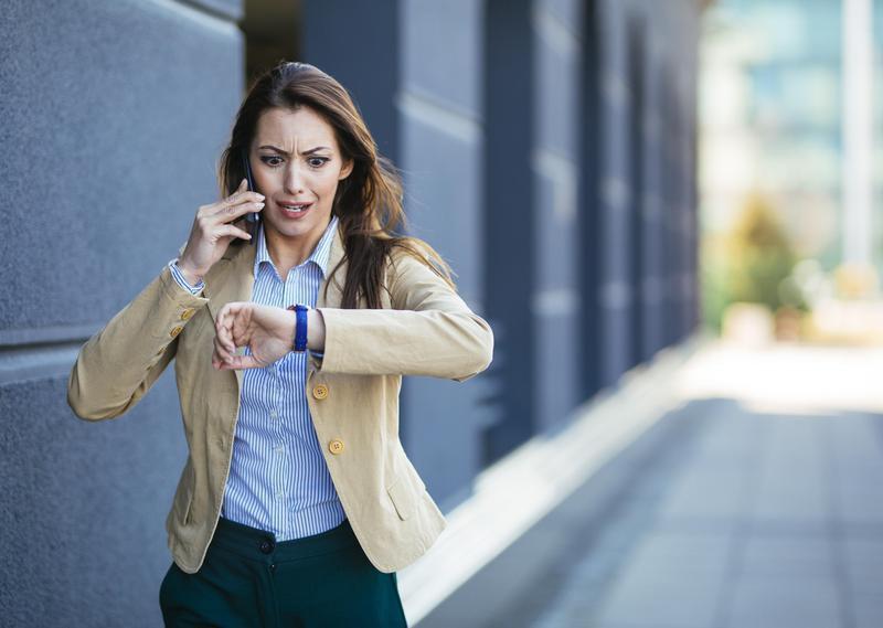 Woman checks time on watch