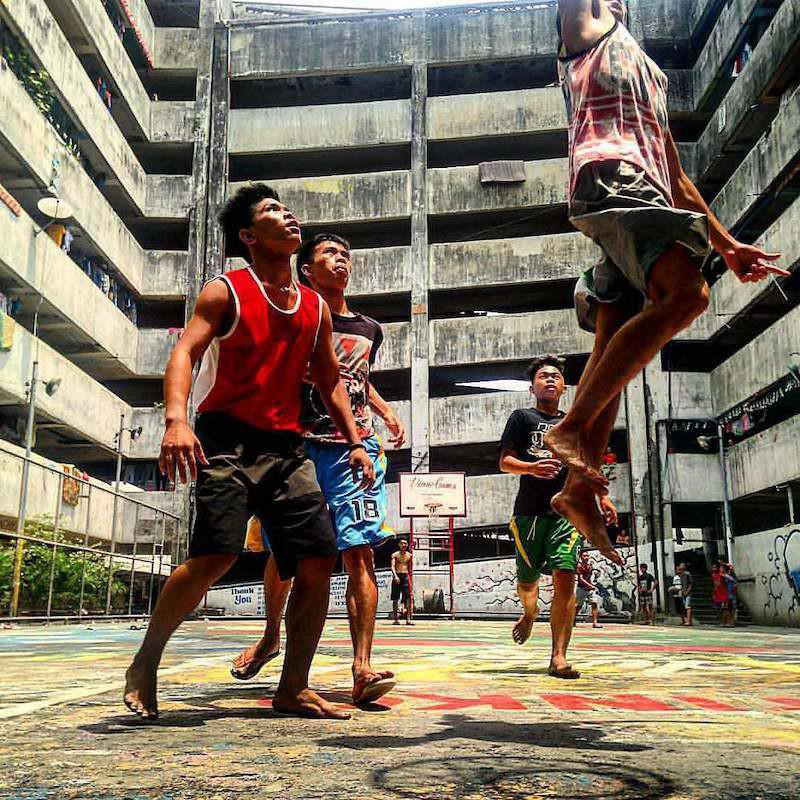 Boys play basketball at the Taguig Tenement