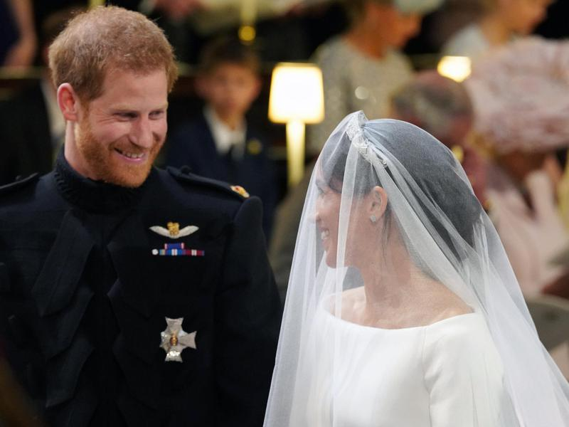 Prince Harry looks at his bride, Meghan Markle