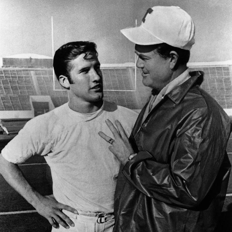 Darrell Royal chatting with star quarterback James Street