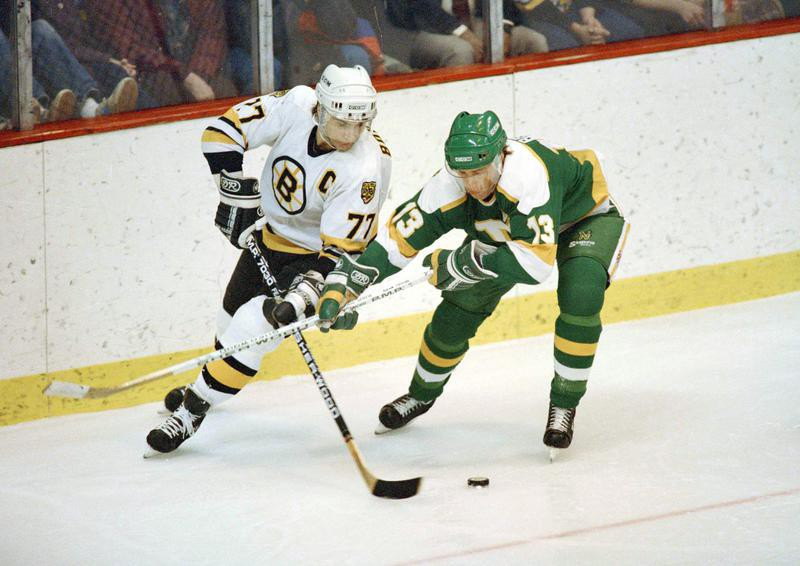 Ray Bourque skates with puck