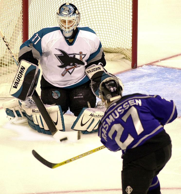 Miikka Kiprusoff blocks a shot on goal