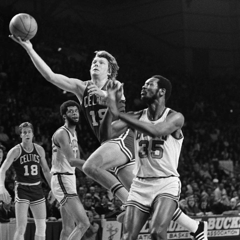 Boston Celtics' Don Nelson takes off