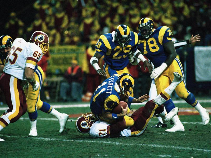 Jackie Slater with Rams teammates in action