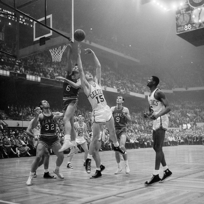 Tommy Heinsohn stretches for rebound