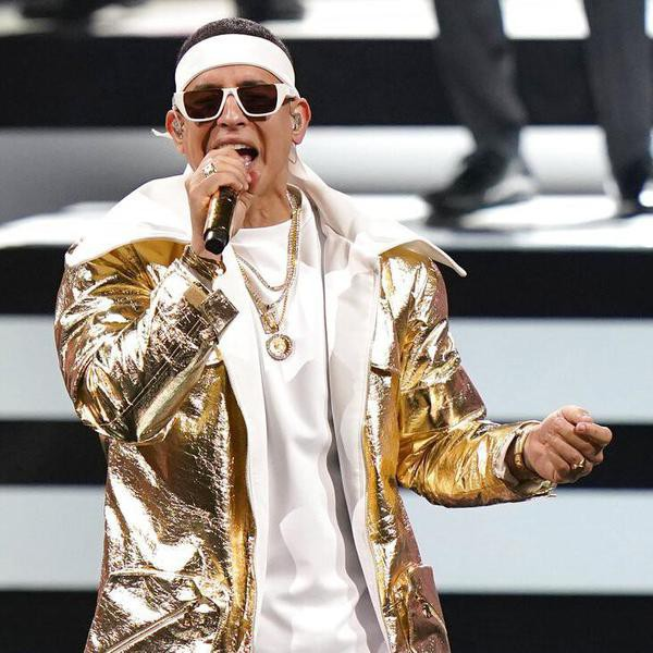 FILE - Daddy Yankee performs at Premio Lo Nuestro on Feb. 16, 2021, in Miami. The reggaeton star will be recognized with the Billboard Hall of Fame Award at the 2021 Billboard Latin Music Awards on Sept. 23, 2021 in Coral Gables, Fla. (AP Photo/Lynne Sladky, File)