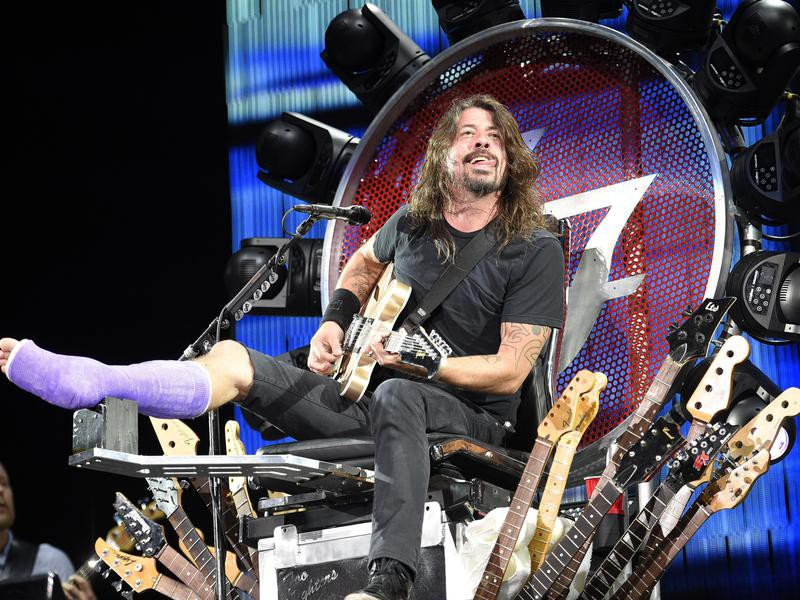 Dave Grohl with a broken leg on his custom throne