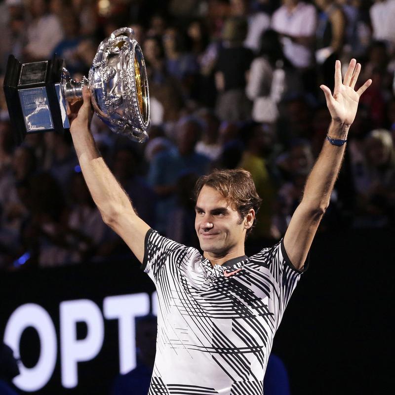 Switzerland's Roger Federer holds trophy