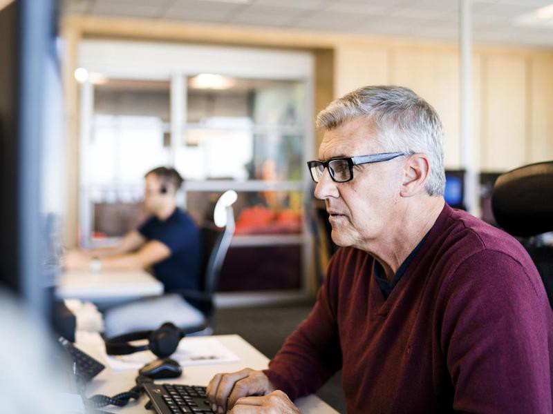 Older man working at computer