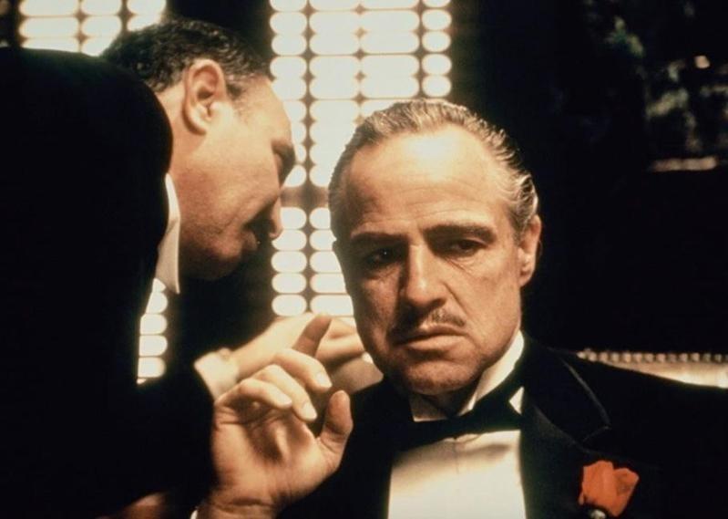 Salvatore Corsitto speaking to Marlon Brando in The Godfather
