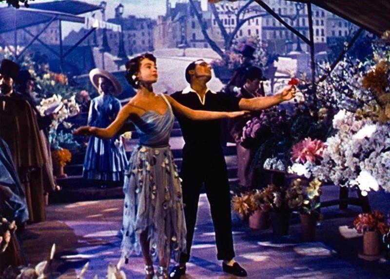 Gene Kelly and Leslie Caron dancing in An American in Paris