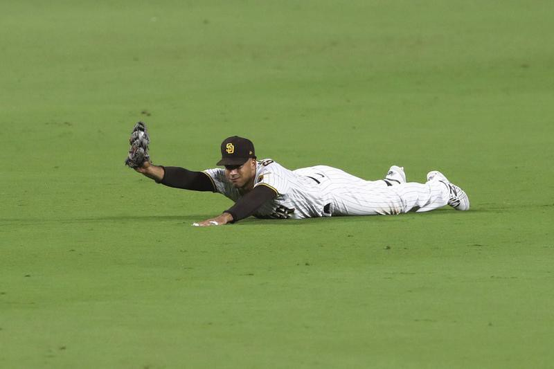 Trent Grisham of San Diego Padres makes diving catch