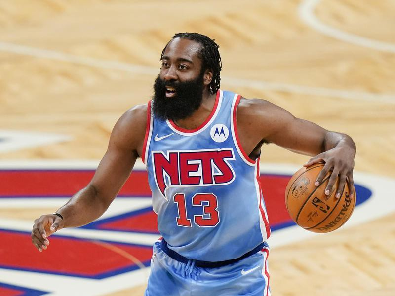 James Harden smiles during game