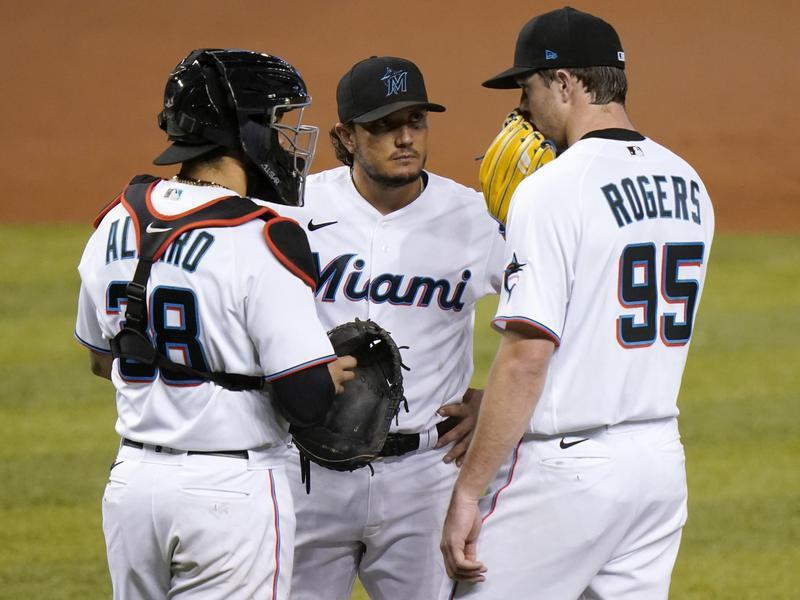 Miami Marlins starting pitcher Trevor Rogers talks with catcher Jorge Alfaro