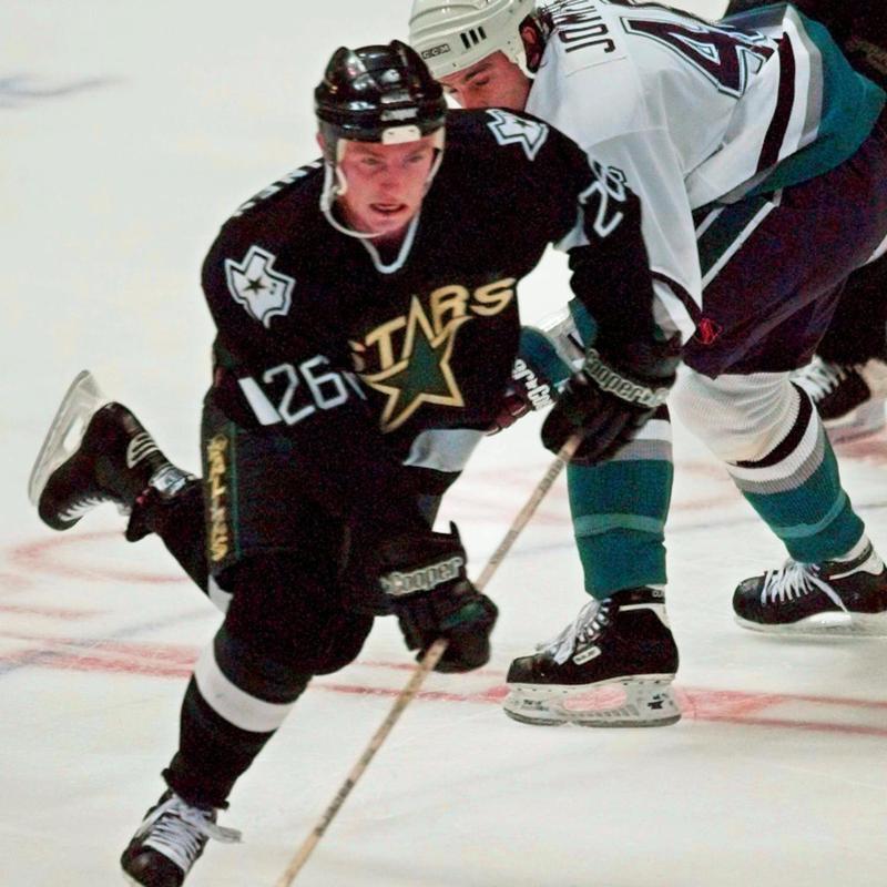 Jere Lehtinen drives down the ice