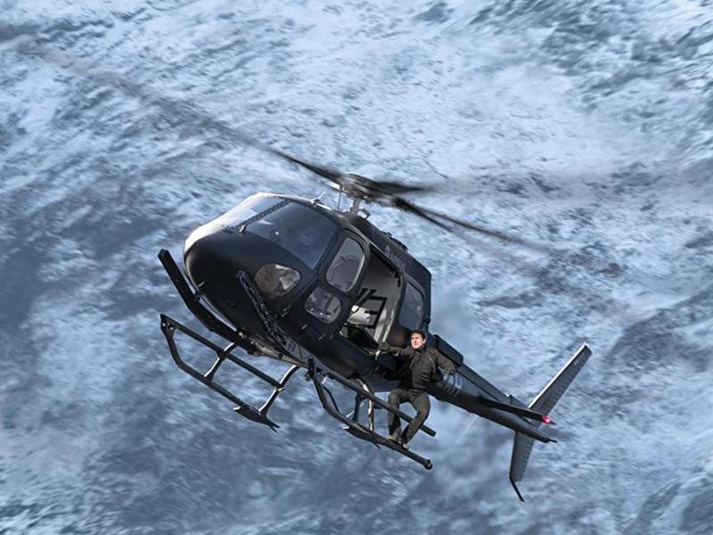 Tom Cruise Hanging From and Piloting a Helicopter