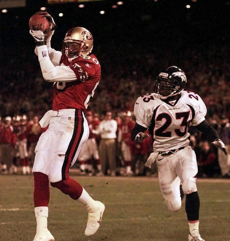 Jerry Rice catches a touchdown pass