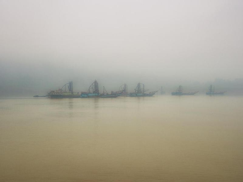 Dredgers on the Yangtze River with heavy air pollution