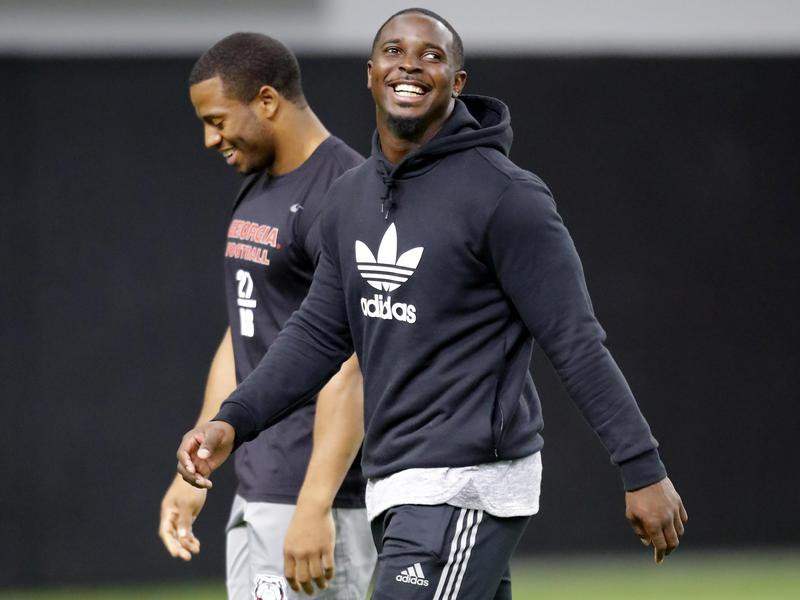 Nick Chubb and Sony Michel walking