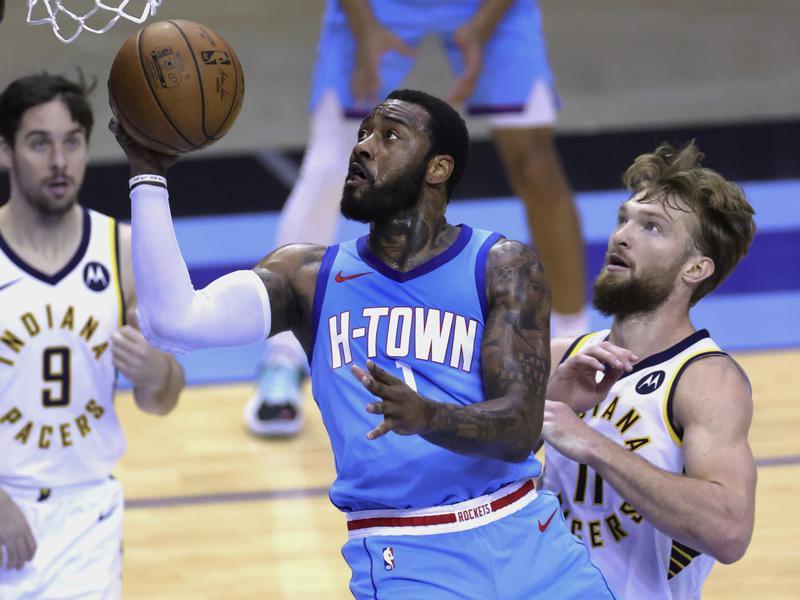 Houston Rockets' John Wall drives to basket