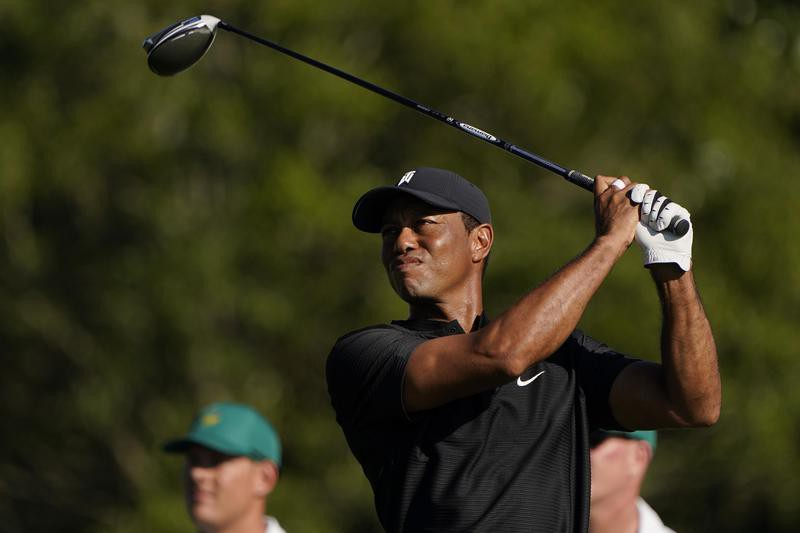 Tiger Woods watches his tee shot