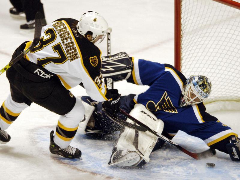 Boston Bruins' Patrice Bergeron scores against St. Louis Blues goaltender Manny Legace