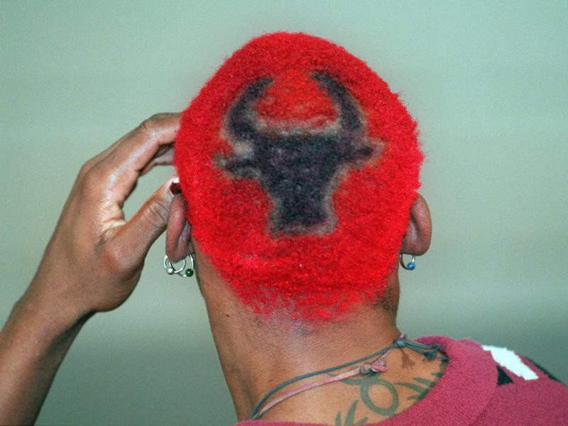Dennis Rodman's red hair with a Bulls insignia