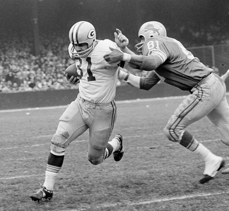Dick Lane brings down Jim Taylor in Detroit