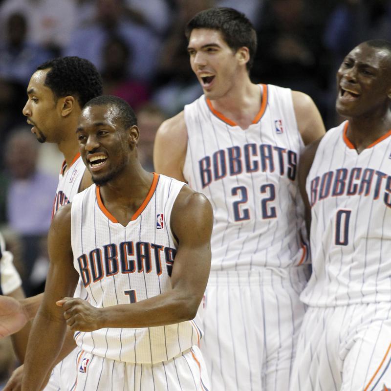 Charlotte Bobcats' Gerald Henderson Kemba Walker, Byron Mullens and Bismack Biyombo celebrate