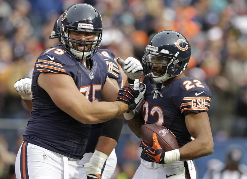 Kyle Long celebrates with Chicago Bears teammate Matt Forte