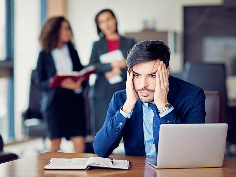 Burnout businessman under pressure in the office