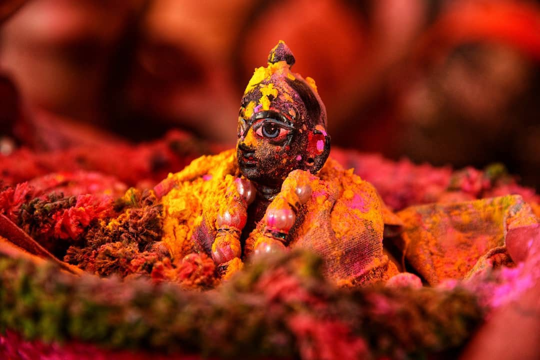 Statue covered in color during Holi
